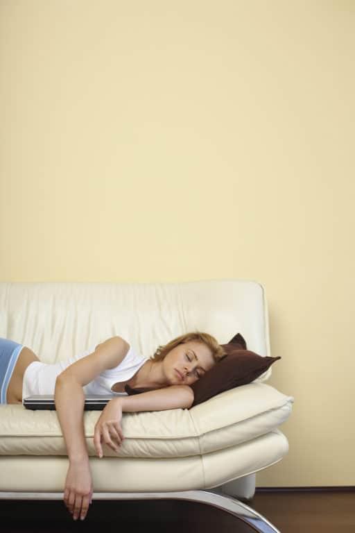 Woman sleeping on sofa