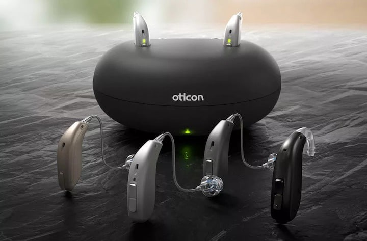 a display of hearing aids and a hearing aid charging device
